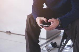 Man using smart phone while waiting