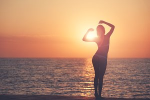 Beautiful woman silhouette over ocea