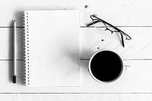 Black coffee with notebook and penci