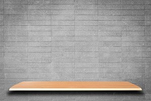 Empty wooden shelves and brick wall