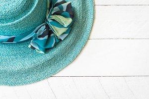 Summer hat on white wooden