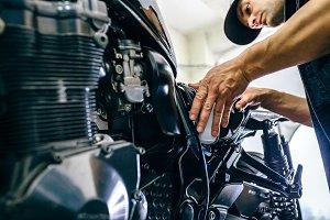 Mechanic repairing customized motorc