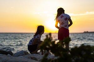 Two girls on the breakwater