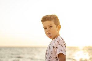 Little kid on the breakwater