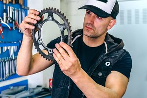Mechanic reviewing motorcycle sprock