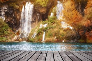 Beautiful autumn forest waterfall at