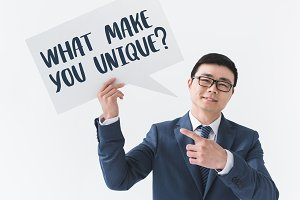 asian businessman with question on c