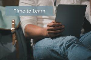 Man learning on digital tablet