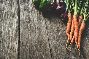 Fresh vegetables on wooden planks
