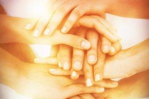 Volunteers putting hands together