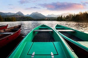 Wooden boats at the mountain lake