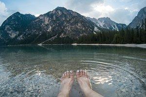 Wonem legs against amazing view of