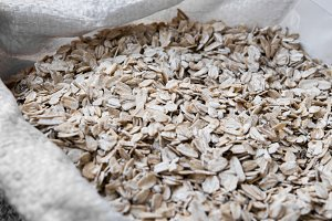 Oat flakes in a bag. Close-up
