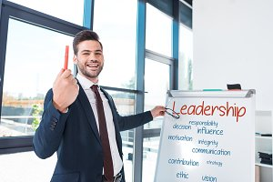 smiling businessman with whiteboard