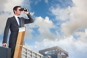 Businessman looking on a ladder