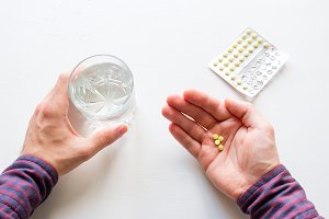 man holding a soothing pill