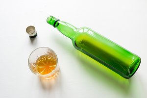 bottle and a glass with alcohol