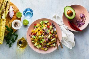 grilled corn , avocado salad with bl