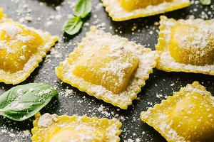 Raw ravioli with basil and flour