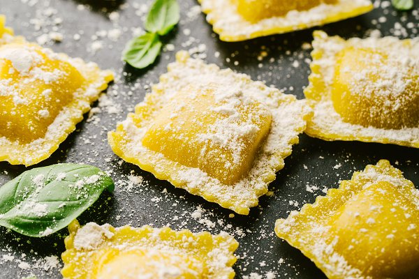 Stock Photos: Valeria Art - Raw ravioli with basil and flour