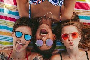 Close up of women enjoying on beach