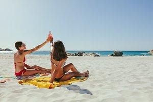 Women sunbathing on beach