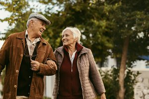 Loving senior couple enjoy a walk