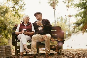 Relaxed senior couple on picnic