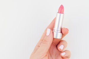 Woman hand with pink lipstick