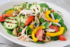 Warm chicken salad with vegetables