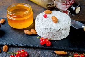cheese with mold with berries and wi