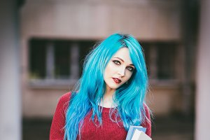 Cute blue-haired girl with books