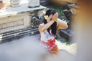 Balinese woman praying