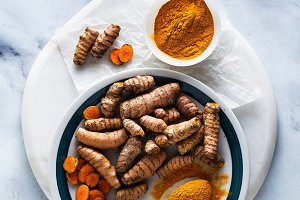 roots of turmeric and powder from it