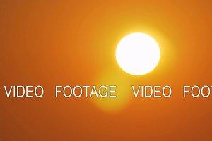 Golden sun in orange sky