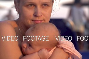 Wistful mother with baby on the