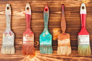 Different colorful brushes on the wo