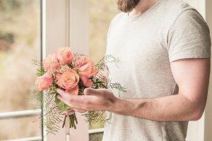 sporty man holding a festive bouquet