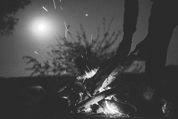 People Stock Photos - River camping at night