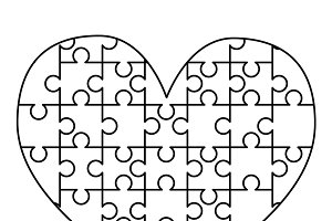 White puzzles pieces in heart shape