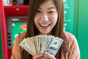 Happy asian young woman holding the