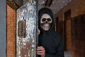Halloween theme of man with skull