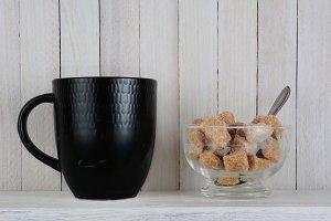 Black Mug and Bowl of Raw Sugar Cube