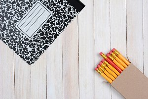 Pencils and Composition Book on Wood
