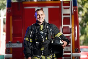 Photo of happy fireman with gas mask