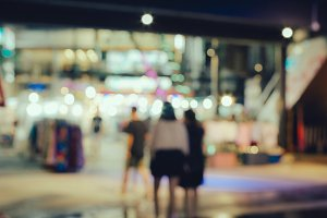 Abstract blurred people walking in