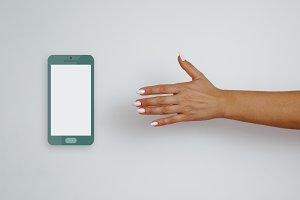 Woman's hand reaches for cell phone