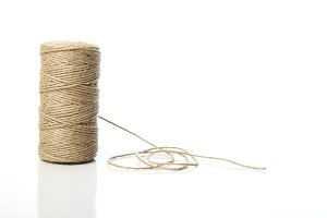 Natural string roll  on white