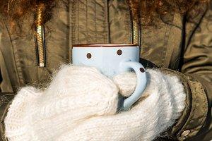 Hot tea in frozen forest.
