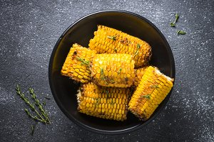 Grilled corn with spices top view on